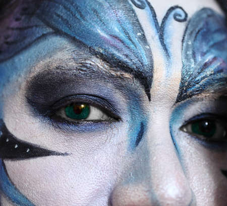 Beautiful man with abstract make up. photo