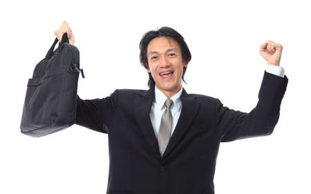 clench: happy businessman raised up Stock Photo