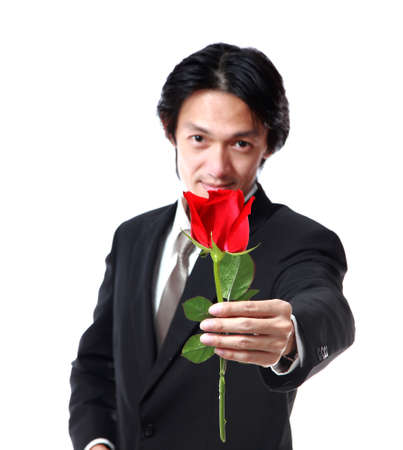 40 years old man: Businessman holding a rose,attractive 40 years old asion man on white background Stock Photo
