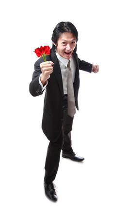 40 years old man: Businessman holding a rose,attractive 40 years old asion man on white background.Valentines day.