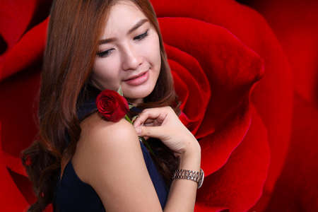 Woman with red rose on Vaentine day.on rose background. photo