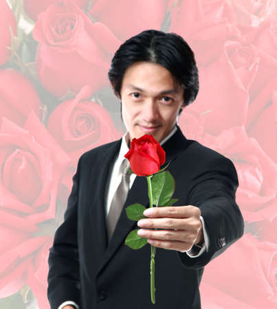 40 years old man: Businessman holding a rose,attractive 40 years old asion man on rose background Stock Photo