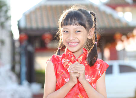 gung: young asian woman wishing you a happy chinese new year
