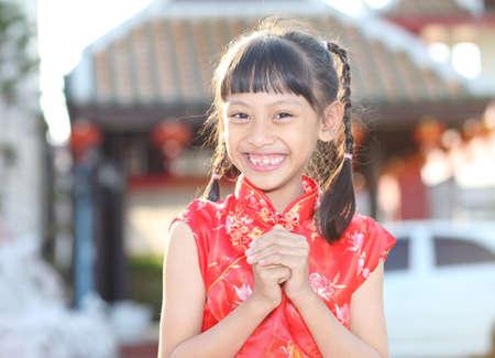 wishing: young asian woman wishing you a happy chinese new year