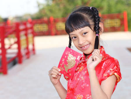 red packet: Beautiful asian girl holding ang pow or red packet monetary gift