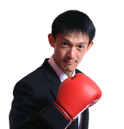 portrait of a business man wearing boxing-gloves isolated on white background. photo