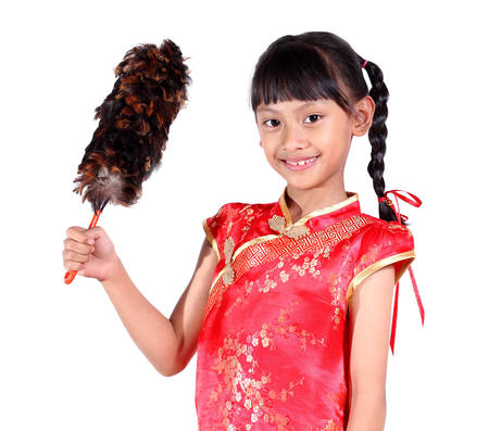 sweep: Beautiful chinese girl with cleaning sweep, white background.