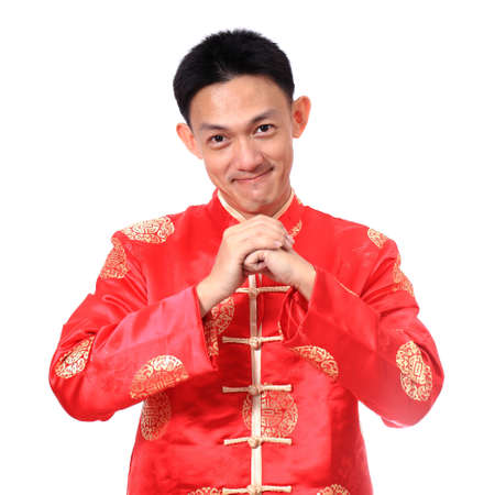 Happy Chinese new year.Young Asian man with gesture of congratulation on white background. photo