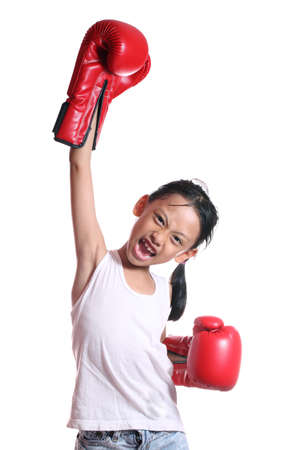 boxing glove: Boxing gloves girl - concept showing aggressive female  flexing muscles wearing boxing gloves isolated on white background. Stock Photo