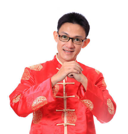 Happy Chinese new year.Young Asian man with gesture of congratulation photo