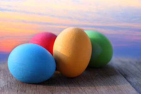 Easter eggs on wooden and blue sky background. photo