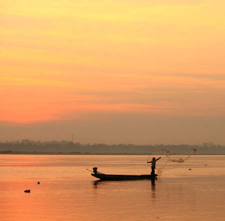 fishmonger: fishmonger in his traditional boat at sunrise