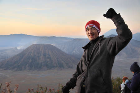A man on top Bromo mountain  happy and celebrating success. Banque d'images