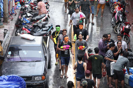 silom: Bangkok April 15:Songkran Festival at Silom Road, Bangkok, is another beat place to celebrate Thai tradition New Year for thais and foreigners on Silom Bangkok April 15,2014 in Thailand Editorial
