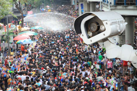 detecting: CCTV Camera Operating outside a people on songkran festival.Security camera detecting the movement of traffic. Editorial