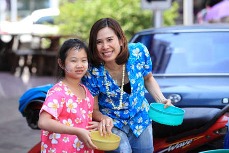 thai people: MUKDAHAN THAILAND-APRIL 13:Mukdahan Songkran festival. Foreign tourists and Thai people enjoy splashing water. on April 13,2015 in Mukdahan,Thailand. Editorial