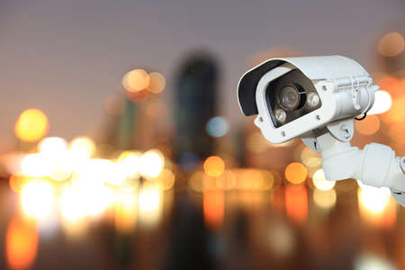 blurring: CCTV with bokeh blurring city in night background.