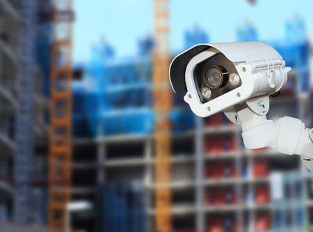 private security: CCTV with Blurring Building construction background.
