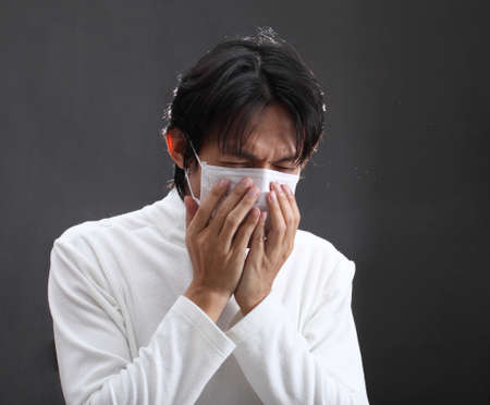 suffered: Strongly coughing young man suffered from asthma Stock Photo