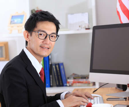 use computer: Business man use computer in office .business man working on computer.