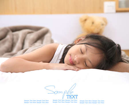 white blanket: Cute Girl Sleeping With White Blanket In Bed. Stock Photo