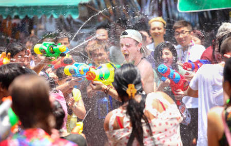 Bangkok, Thailand - April 13: Tourists shooting water guns and having fun at Songkran festival, the traditional Thai New Year, on Khao San Road in Bangkok, Thailand. Editorial