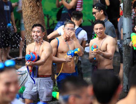 Bangkok Thailand - April 13 2016 : People celebrating the Songkran festival or Thai New Year's festival on Silom street in Bangkok Thailand. 新聞圖片