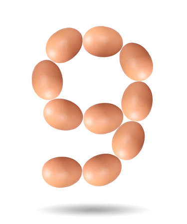 Number nine made of Easter Eggs isolated on white background.Chicken eggs number 9 isolated on white background. 版權商用圖片