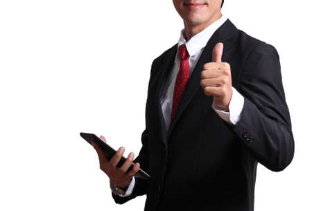 Businessman hand holding taplet showing the thums up gesture.