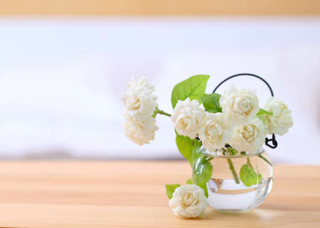 White jasmine flowers in a glass.Beautiful jasmine flower in the pot on the bedroom.