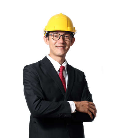 Portrait of happy young engineer man with hard hat on white background.Senior businessman looking at camera with a bright smile, isolated on white background. 版權商用圖片
