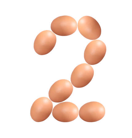 Number two made of Easter Eggs isolated on white background.Chicken eggs number 2 isolated on white background. 版權商用圖片