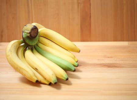 Bananas on wooden background banana, beverage, food, fresh banana on copy space. 版權商用圖片