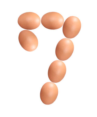 Number seven made of Easter Eggs isolated on white background.Chicken eggs number 7 isolated on white background.