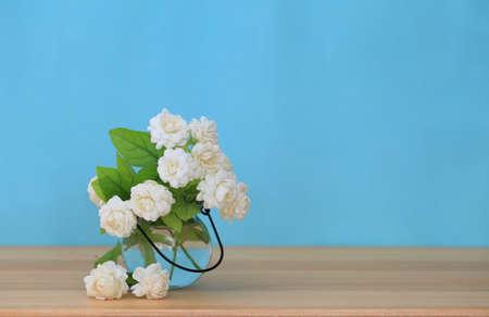 Beautiful jasmine flower in the pot on green blur background. 版權商用圖片
