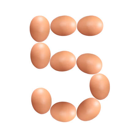 Number five made of Easter Eggs isolated on white background.Chicken eggs number 5 isolated on white background.