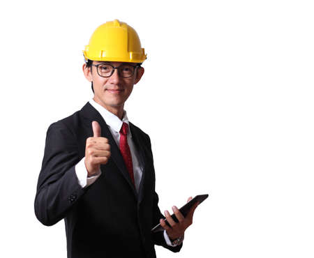 Businessman engineer hat make signal by thumb on white background.Engineering industrial industry businessman hand holding taplet.
