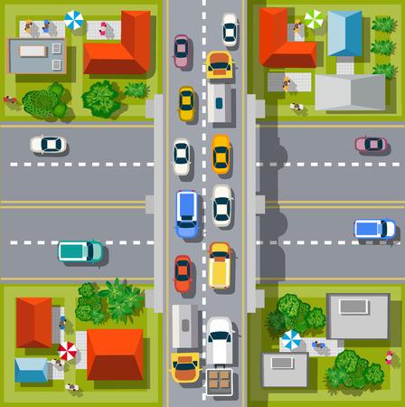 Vista superior de la ciudad. cruce de caminos urbanos con coches y casas