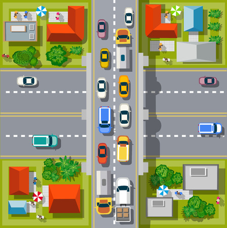 Top view of the city. Urban crossroads with cars and houses