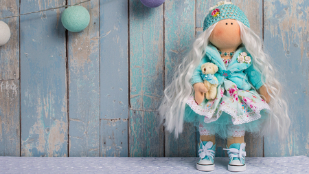 tilde doll on a blue background of the boards with