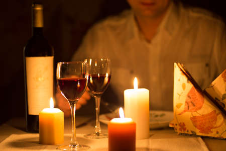 Romantic dinner with candles and wine