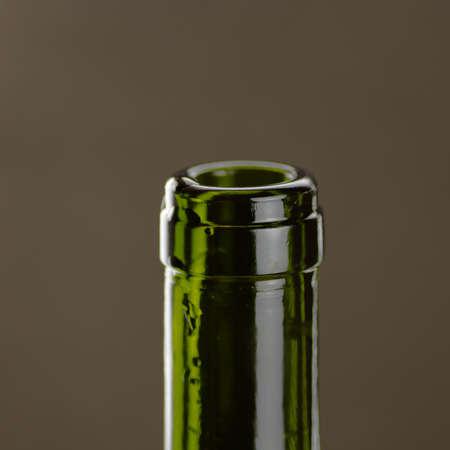 bottleneck: Bottleneck of green glass on black background Stock Photo