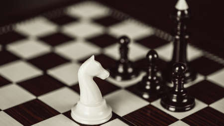 Single chess piece against many enemies Stock Photo