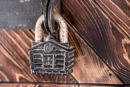 hasp: old metal padlock at wood door Stock Photo