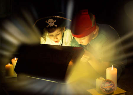 exultation: Childhood dreams. Cute girl and adventurous boy found a treasures. Happy young pirates.