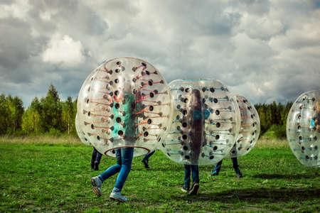 Bumperball. Teens play bumper-ball outdoor Standard-Bild