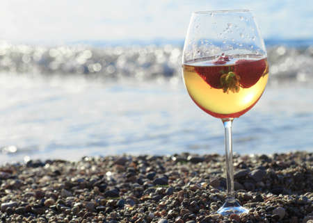 Frozen strawberry sangria cocktail at the edge of the sea. Stock Photo