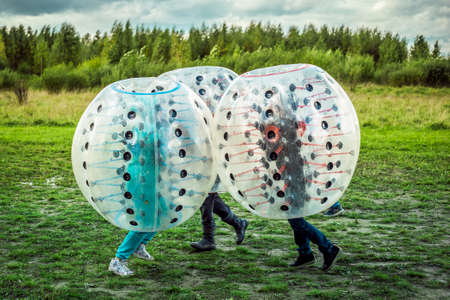 Bumperball. Teens play bumper-ball outdoor Archivio Fotografico