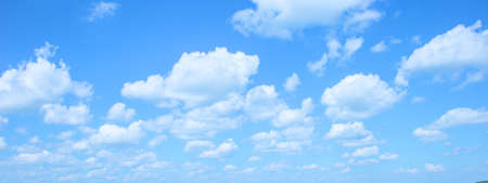 many little fluffy clouds in blue sky in summer. 版權商用圖片