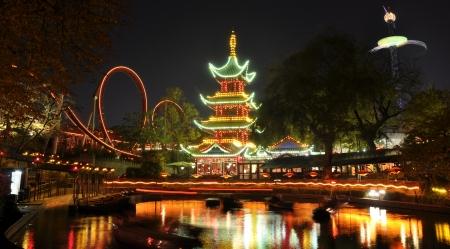 Tivoli by night - the amusement park of Copenhagen Denmark Standard-Bild